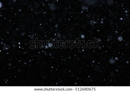 Winter background. falling snow isolated on pure black background