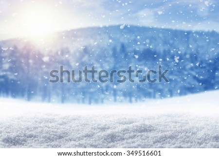 Winter background, falling snow over winter landscape with copy space - stock photo