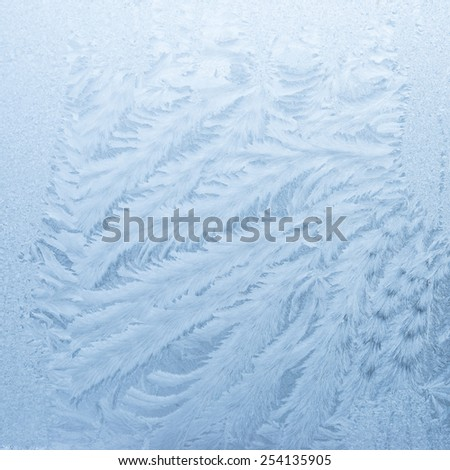 Winter background - ice crystals on window - stock photo