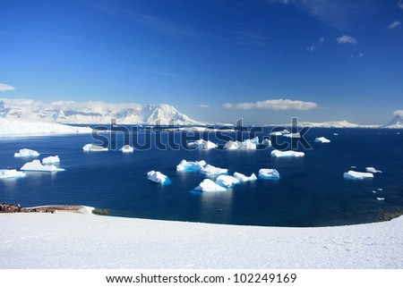 winter background Iceberg in water - stock photo