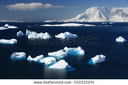 winter background Iceberg in water - stock photo