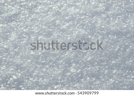 Winter background image with a detailed view of fresh snow showing large snowflakes