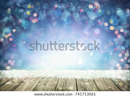 Winter background with frost fir branches and rustic wooden planks