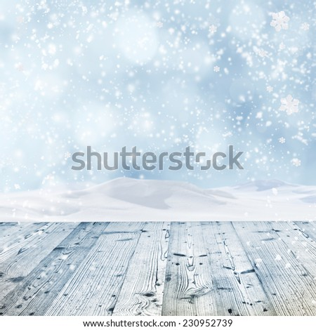 Winter background with wooden table - stock photo