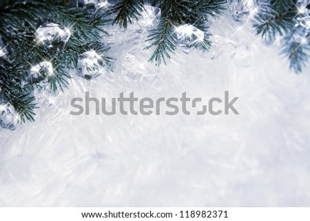 Winter backround with spruce branches and cubes of ice - stock photo