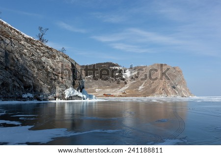 Winter Baikal - ice, snow, rocks, reflection