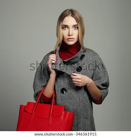 Winter beautiful Woman with Handbag.Beauty Fashion Girl in topcoat.Shopping - stock photo