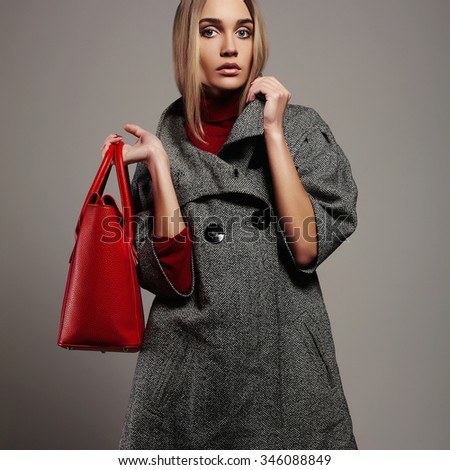 Winter beautiful Woman with red Handbag.Beauty Fashion Girl in topcoat.Shopping - stock photo