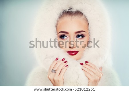 Winter Beauty. Fashion Portrait of Cute Winter Woman with Makeup. Face Closeup