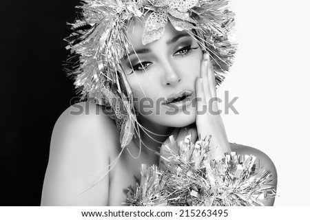 Winter Beauty. Stylish Party Girl with Glamor Silver Hairstyle. Vogue style model with Holiday Silver Makeup and Hairstyle over Black and White Background