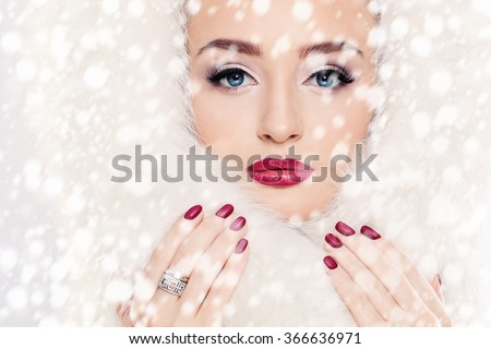 Winter Beauty. Woman and Snow - stock photo