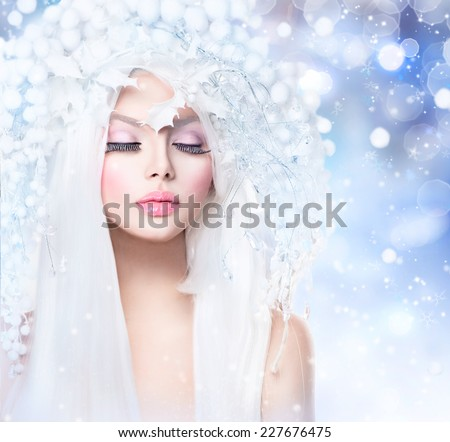 Winter Beauty Woman. Beautiful Fashion Model Girl with Snow Hair style and Make up. Holiday Makeup. Winter Queen with Snow and Ice Hairstyle  - stock photo