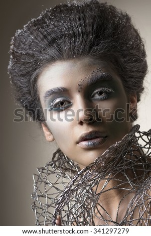 Winter Beauty Woman. Christmas Girl Makeup. Beautiful Make-up with False Eyelashes and crystals on her Lips. Snow
