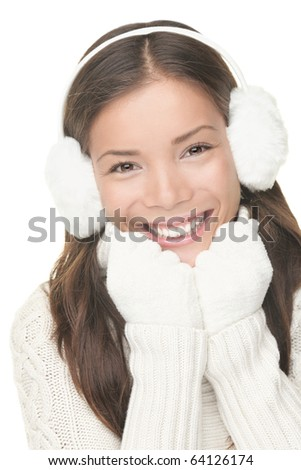Winter beauty woman smiling playful, cute and happy looking at camera. Portrait of mixed Asian / Caucasian young woman isolated on white background - stock photo