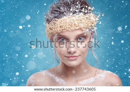 Winter beauty young woman portrait,model creative image with frozen makeup, with porcelain skin and long white lashes showing trendy, Ice-queen, Snow Queen, studio  - stock photo