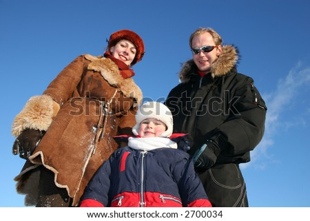 winter boy with parents