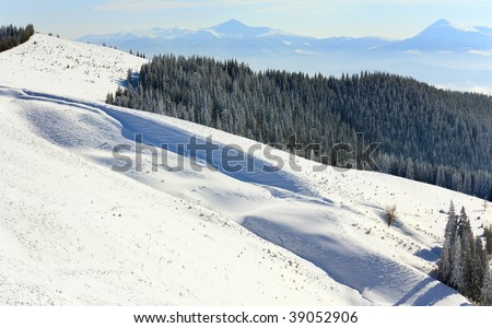winter calm mountain landscape (view from Bukovel ski resort (Ukraine, Dovga mount) to Goverla)