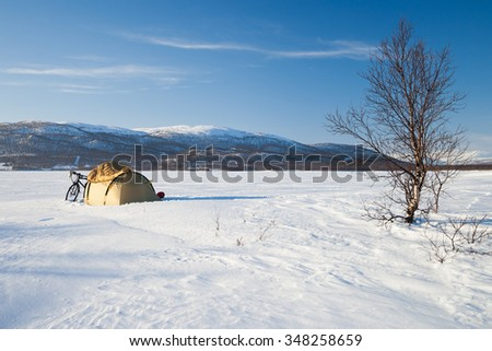 winter camping on a frozen lake in sweden - stock photo