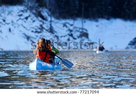 Winter canoeing - stock photo