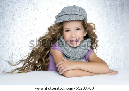 winter cap wool scarf little fashion girl wind on hair portrait gray background - stock photo