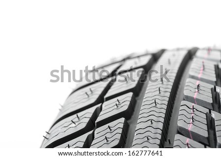 Winter Car tires close-up wheel profile structure on white background - stock photo