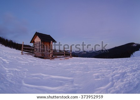 Winter Carpathian mountains and a village before sunrise, panoramic view, rural landscape