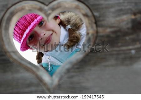 Winter, child, apres ski - young girl enjoying winter vacation - stock photo