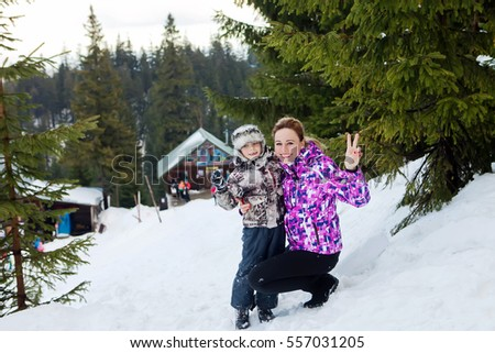 Winter child with mom