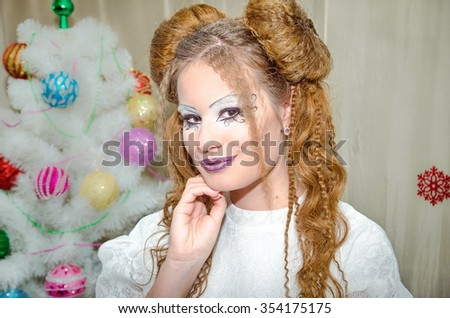 Winter Christmas eyes make up with glitter eyeshadows. Party art model Woman makeup. Creative Girl Holiday Make-up. - stock photo