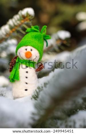 Winter, Christmas - Happy, smiling snowman on snow - stock photo
