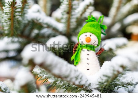Winter, Christmas - Happy, smiling snowman on snow (copy space) - stock photo