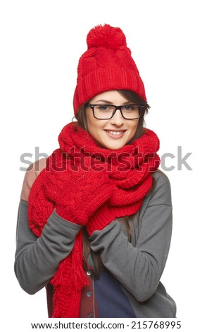 Winter, christmas, holidays concept. Smiling beautiful woman in glasses and in red hat, scarf and mittens over white background