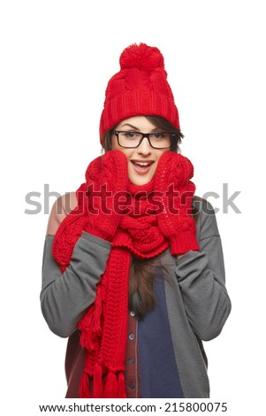 Winter, christmas, holidays concept. Surprised excited woman in glasses and in red hat, scarf and mittens over white background