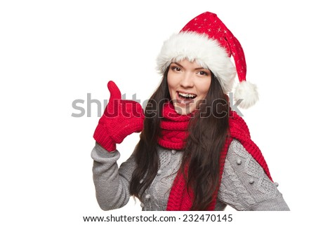 Winter, christmas, holidays success concept. Closeup of smiling beautiful woman in Santa hat gesturing thumb up, over white background - stock photo