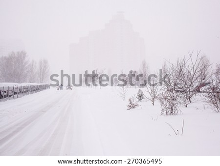 Winter city landscape with fog. - stock photo