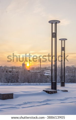 Winter cityscape on sunset