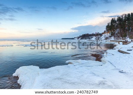 Winter coastal landscape with ice and snow on the beach. Gulf of Finland, Russia - stock photo
