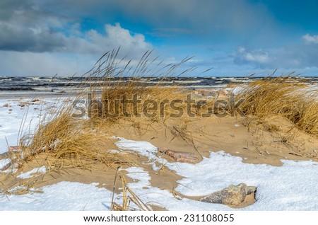 Winter coastline and stormy Baltic sea - stock photo