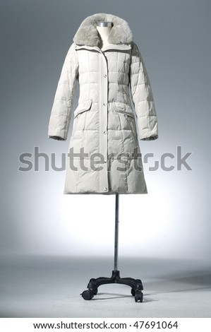 winter coat dress on mannequin - stock photo