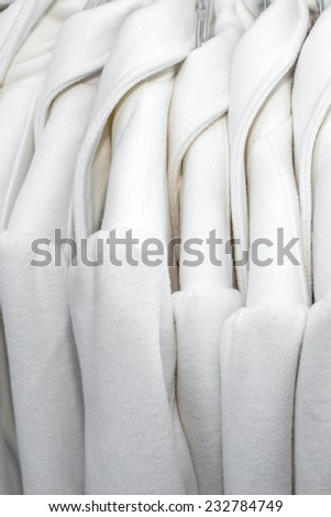 Winter coats outside a clothing store - stock photo