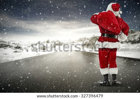 winter cold day on road and red sack red santa claus and free space for your text  - stock photo
