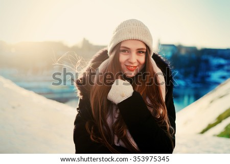 Winter cold snow weather woman outdoor smiling happy portrait