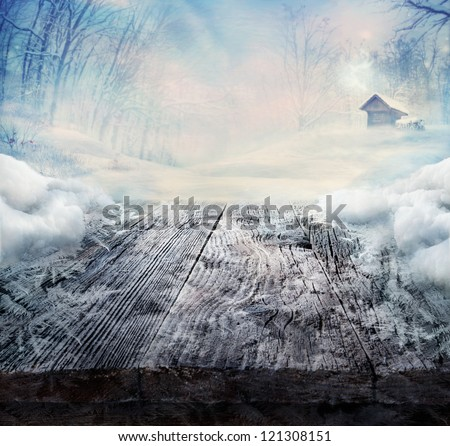 Winter design - Christmas background with Frozen wooden table with landscape. Snow and ice on wooden table with snowy forest with cabin in the background. - stock photo
