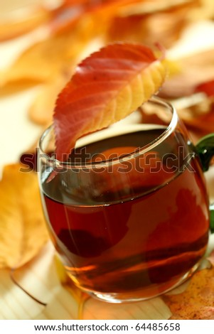 winter drink and autumn leafs - stock photo