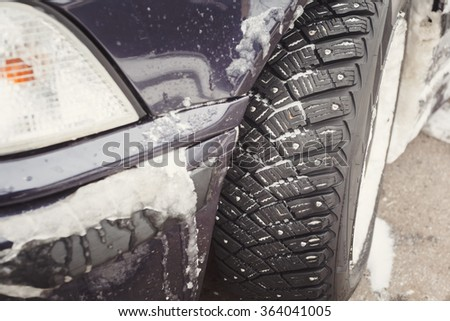Winter driving conditions. Snow storm, snow tires, driving hazards - stock photo