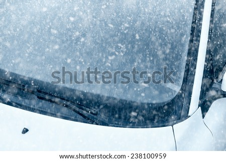 Winter Driving - Ice Covered Windshield - Snow on an ice covered windshield with copy space. - stock photo