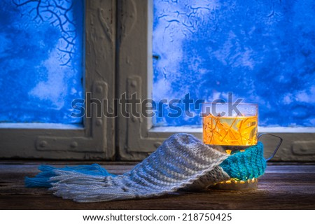 Winter evening and hot tea - stock photo