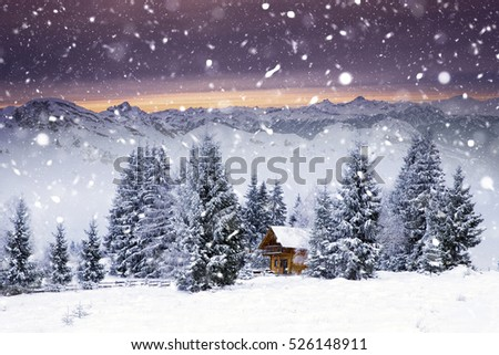 Winter fairy-tale cottage in woods at sunrise. Christmas concept.