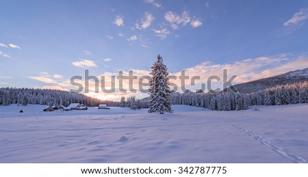 Winter fairytale in the mountains at sunset