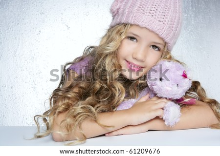 winter fashion cap little girl hug teddy bear smiling silver background - stock photo